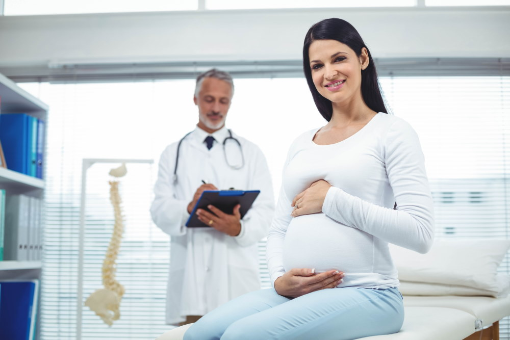 Pregnant Woman With Her Doctor