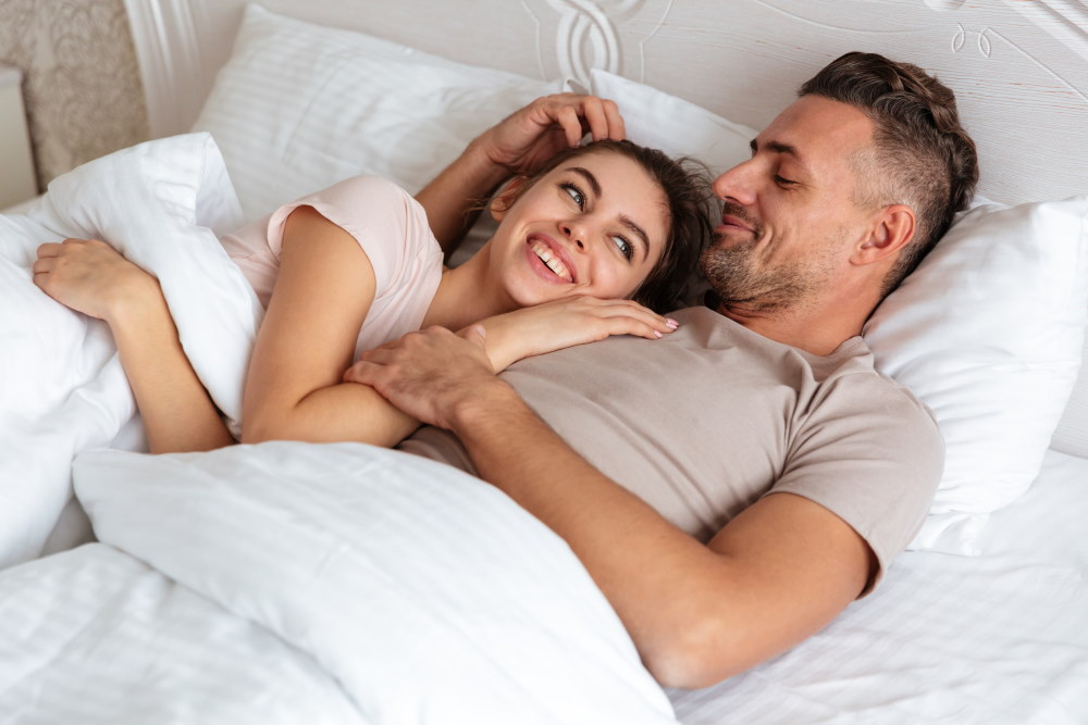 Happy Couple At Bed