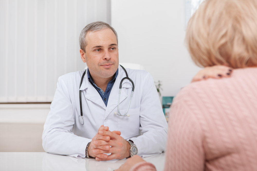 Doctor talking to mature woman
