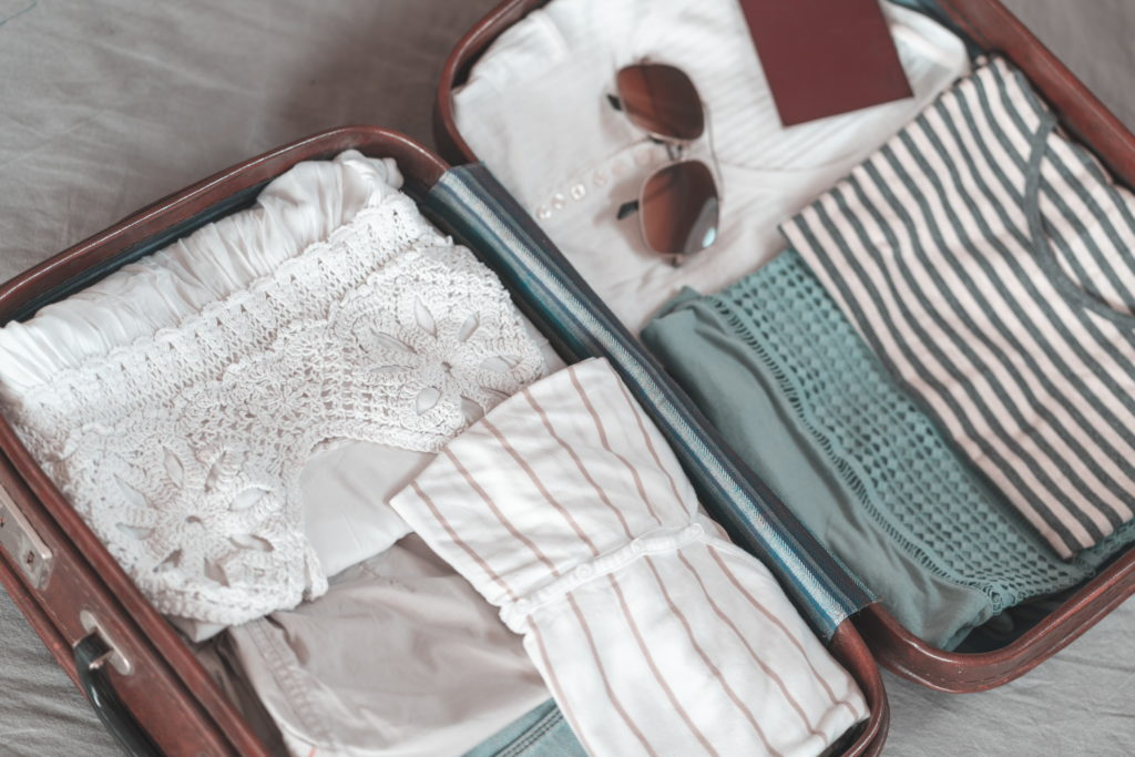 Ready suitcase for summer vacations